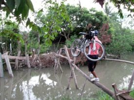 Mekong Delta, 2008: Even on bicycles, we needed a little help.