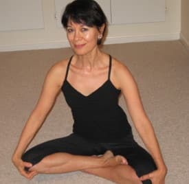 "Laura Venecia Rodriguez, author of ""----,"" demonstrates the Half-Lotus pose."