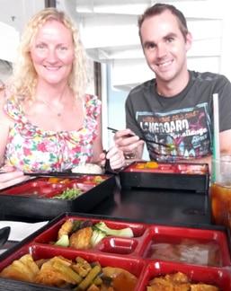 Matt and Deb -- slurping curry in Penang, Malaysia.