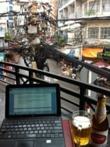 My late-afternoon, temporary office on a balcony over Bui Vien Street. (The beer beside my laptop means I've achieved my word-count goal for the day.)