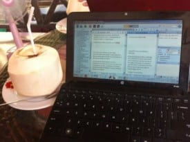 A commpter and a coconut: Key components of my writing escape this week on the Thai island of Phuket.
