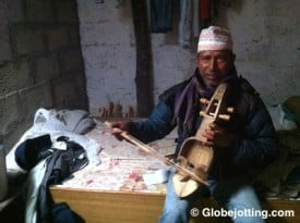 Ram Lal plays the sarangi at his home in Pokhara, Nepal.