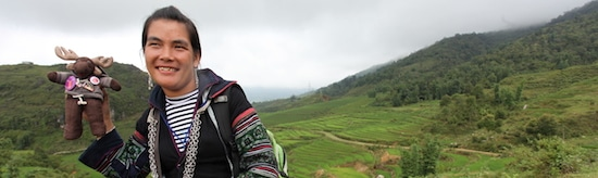 Our Sapa tour guide, Mo, hangs out in the rice paddies with my trusty travel mascot, Sven Wondermoose.