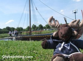 Globejotting mascot Sven Wondermoose chills out in front of a replica Viking ship at the Viking Ship Museum in Roskilde, Denmark.