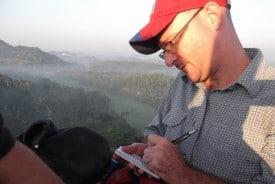Taking notes in a hot air balloon over Hikkaduwa, Sri Lanka.