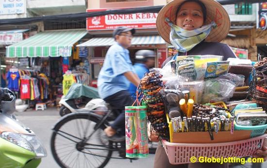 Souvenir seller on Bui Vien Street in Saigon