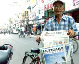 Newspaper vendor on Bui Vien Street in Ho Chi Minh City (Saigon), Vietnam.