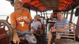 My pal, Phúc, captains us down the Mekong River. (If you're looking for a private tour guide in Saigon or the Mekong Delta, Phúc is licensed and he's great. He'll show you real, authentic Vietnam and take you places most tourists never see. Drop me an e-mail for more info!)